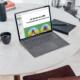 Bärbar dator på bord med broschyren från LHON Eye Society på skärmen